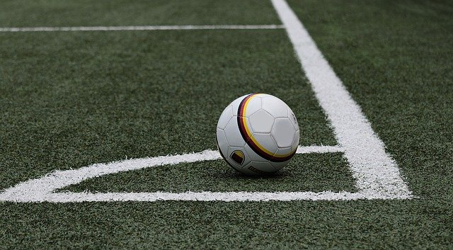 A close up of a football ball on a field